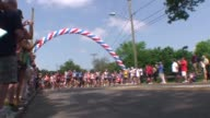 Runners in road race Start under balloon arch