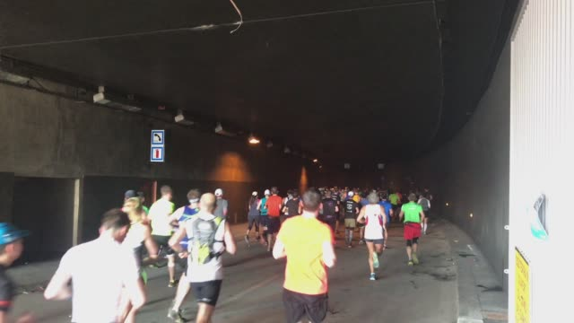 Runners in tunnel during the french sport event Paris Marathon 2017