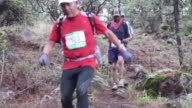 Runners including several hundred wearing traditional clothing and hauraches from native Mexican tribes participate in a mountainous ultra marathon...