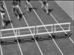 B/W 1965 SLO MO HA Runners jumping hurdles / documentary