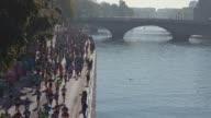 Runners on the Seine banks during the sport event Paris Marathon 2017