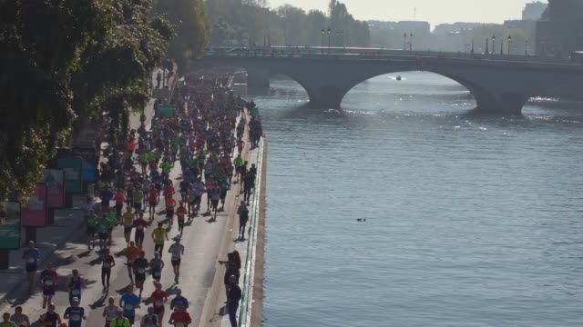 Runners on the Seine banks during the sport event Paris Marathon 2017
