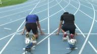 MS TU Runners running on starting block / Seoul, South Korea