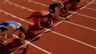 Runners sprint out of starting blocks at the beginning of a race.