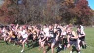 Runners start cross country race head down course