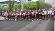 runners start race main street running
