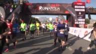 Runners take part in the 12th annual International Runatolia Marathon in Antalya Turkey on March 05 2017 90yearold runner Safter Kartoglu talks to...