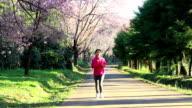 running along at park in the morning, Dolly Shot