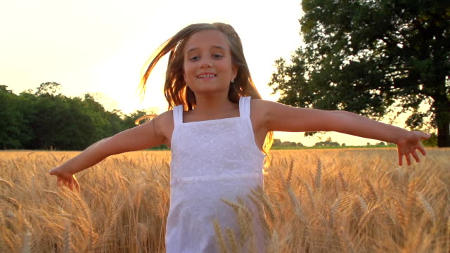HD SUPER SLOW-MO: Running In Wheat