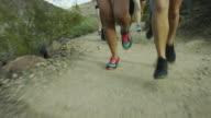 Running legs and feet tracking shot