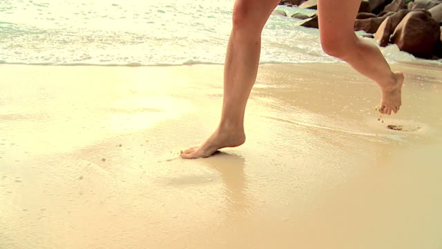 HD SLOW-MOTION: Running On A Beach