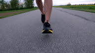 HD SUPER SLOW-MO: Running On A Country Road