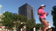 Running race in Wall Street Area Manhattan four shots