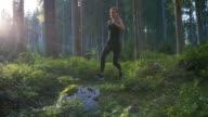 Running through woods at sunset