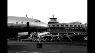 Runway LaGuardia Airport 4engine American Overseas 'Flagship Sweden' Airlines Constellation airplane landing / Tarmac outside LaGuardia Airport...