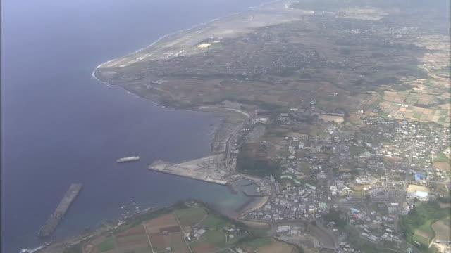 A runway lines the coast near the residential neighborhood of Amagi Town on Tokunoshima Island.