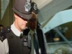 Rupert Murdoch and James Murdoch are escorted by the police following the NOTW phone hacking scandal UK