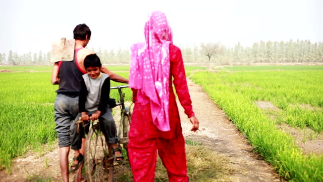 Rural Family going to the field with riding Bicycle