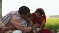 Rural family saving money in piggy bank