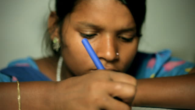 Rural Indian girl studying
