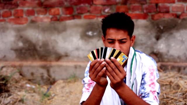 Rural men holding credit cards