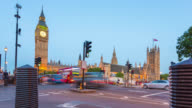 Rush hour traffic at the front of Houses of Parliament and Big Ben.