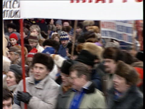 Rushes Gorbachev's politics called into question Anticommunist / democratic demonstrations in Moscow vs demonstrators holding banners and Russian...