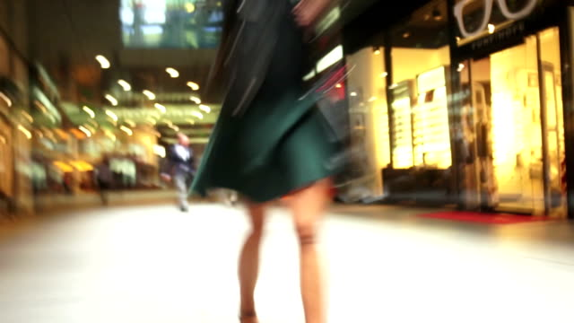 TL POV Rushing Through Luxury Shopping Center