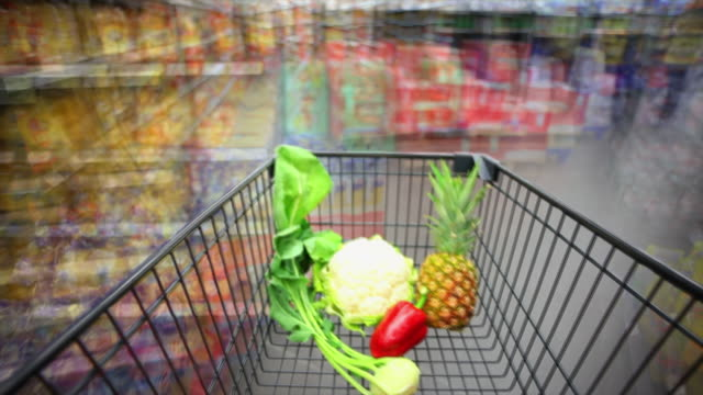 T/L Rushing With Shopping Cart In Supermarket