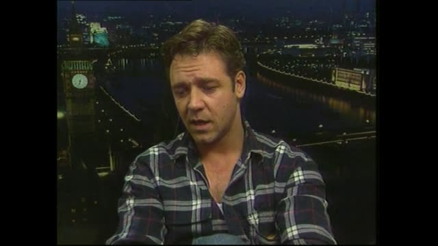 Russell Crowe speaking in 2000 about split New Zealand and Australian heritage and which sports teams he supports during satellite interview with...