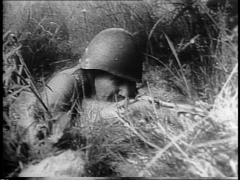 Russian Artillery platoon on the front and in action / explosions on a hill on the battlefield / montage of Russian soldiers in trenches ducking...