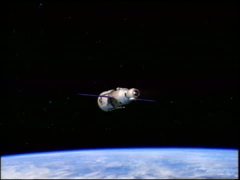 COMPUTER ANIMATED Russian Functional Cargo Block module of International Space Station over Earth