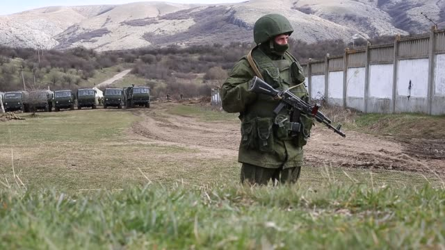 MS Russian military personnel surround a Ukrainian military base on March 19 2014 in Perevalnoe Ukraine Russia's Constitutional Court ruled...