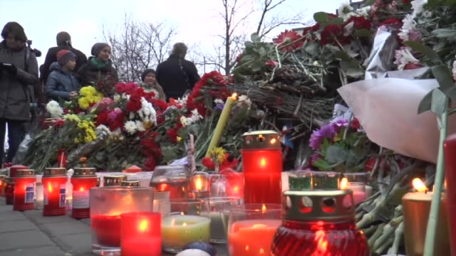 Russian people leave flowers and candles to a memory corner in front of French embassy to express their sympathy and solidarity to French people and...