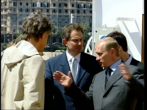 Russian President Vladimir Putin and British Prime Minister Tony Blair MP standing chatting to Sir Bob Geldof and U2 front man Bono LMS SIDE Putin...
