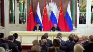 Russian President Vladimir Putin and Chinese President Xi Jinping hold a joint press conference after signing a joint statement in the Kremlin on May...