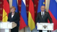 Russian President Vladimir Putin and German Chancellor Angela Merkel hold a joint press conference at the Moscow Kremlin on May 10 2015 in Moscow...