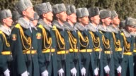 Russian President Vladimir Putin and Kyrgyzstan's President Almazbek Atambayev inspect honor guard during official welcoming ceremony in Bishkek...