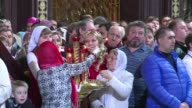 Russian President Vladimir Putin and Premier Dmitry Medvedev attend an Orthodox Easter ceremony in Moscow