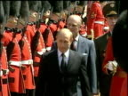 Russian President Vladimir Putin inspects grenadier guards of honor at Buckingham Palace during State Visit Prince Phillip walks behind 24 Jun 03