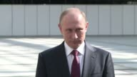 Russian President Vladimir Putin left the door open to intervening in Ukraine Thursday in a thinly veiled threat that coincided with the opening of...