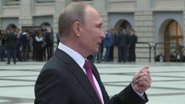 Russian President Vladimir Putin responds to a question from a BBC reporter on opposition leader Alexei Navalny by accusing the British broadcaster...