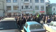 Russian riot policemen stand guard as people take part in an opposition rally on March 26 2017 in MoscowRussian police have detained more than 500...