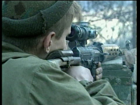 Russian soldiers aim and fire rifles Jan 00