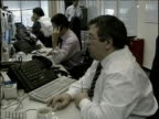 Russian stockbrokers working at computer screens and on telephones Russia
