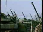 Russian tanks gun turrets raised and aimed at Chechen Rebel positions in hills Grozny 18 Feb 00