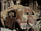 WS rusted and destroyed car buried under rubble / Wiesbaden Germany