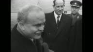 Honor guard waits in formation / Soviet Foreign Minister Vyacheslav Molotov deplanes greeted by officials / he shakes hands with Czech Deputy Prime...