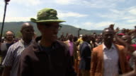 Rwandan President Paul Kigame greeting crowds of supporters at rally
