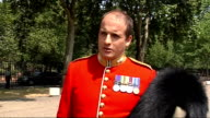 Ryan taking off bearskin Major Edward Paintin interview SOT Close ups of guard's tunic Paintin interview SOT